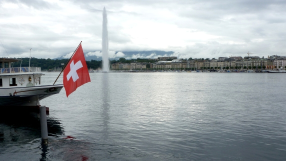 All things Swiss: Lake Geneva's Jet d'Eau sets up the city and the Swiss Alps for a perfect backdrop