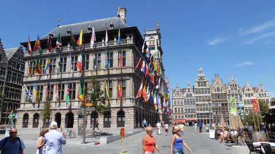 This city hall of Antwerp is decorated year-round with 87 unique flags, and makes a great backdrop for cafes and restaurants Antwerp, Belgium July 24, 2014