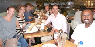 Enjoying dinner with other expats