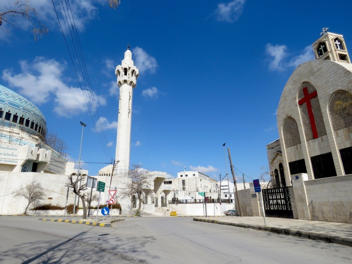 King Abdullah Mosque sits right across from a Greek Orthodox Church in Amman, Jordan