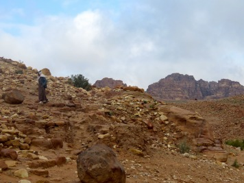 A bedouin in Nikes walks in a desolate area of Petra - by Anika Mikkelson - Miss Maps - www.MissMaps.com