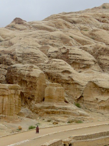 A bedouin man walks along an otherwise deserted path in Petra - by Anika Mikkelson - Miss Maps - www.MissMaps.com