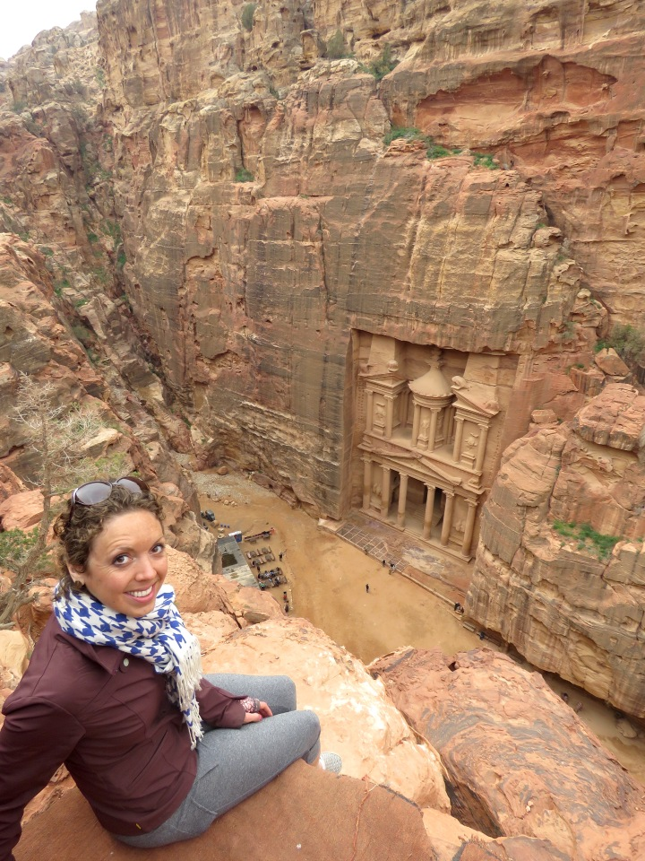 Sitting on a cliff overlooking Petra's Treasury - the best view in Jordan - by Anika Mikkelson - Miss Maps - www.MissMaps.com