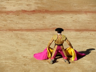 A famous torero waits for his bull during Pamplona's San Fermin Festival - Running of the Bulls - by Anika Mikkelson - Miss Maps