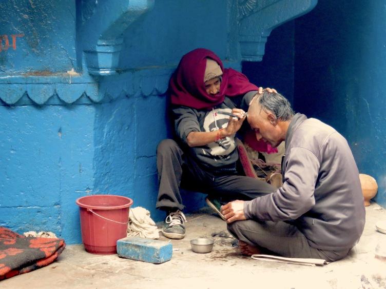 Traditional Hindi Head Shaving before cremation services for family members - Varanasi, India