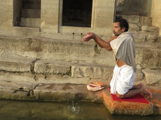 A Man Cleanses in the River Ganges - Varanasi India - by Anika Mikkelson - Miss Maps