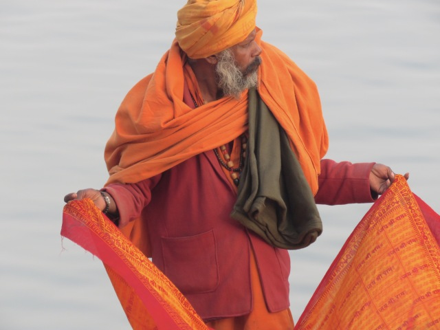 His color is so striking - A man on the Holy Ganges River - Varanasi India - by Anika Mikkelson - Miss Maps