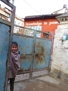 "A young boy walked through the gates of his school in Kathmandu, Nepal, smiling in front of a building where ""Knowledge is Power"". Read his story at www.beautifulfillment.com"
