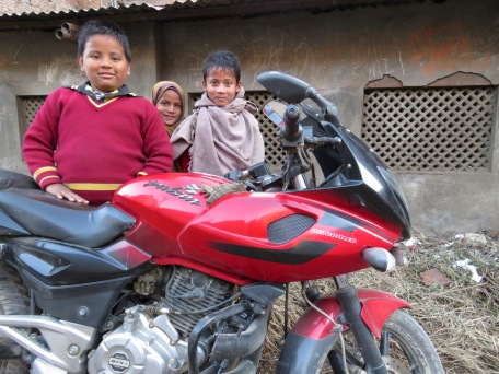 Schoolchildren Eager to show off their father's new bike - Kathmandu, Nepal - by Anika Mikkelson - Miss Maps