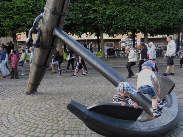 IMG_5469Two young boys play on a large anchor sculpture near Nyhavn Canal in Copenhagen, Denmark - read about the sites and activities in Copenhagen at www.beautifulfillment.com