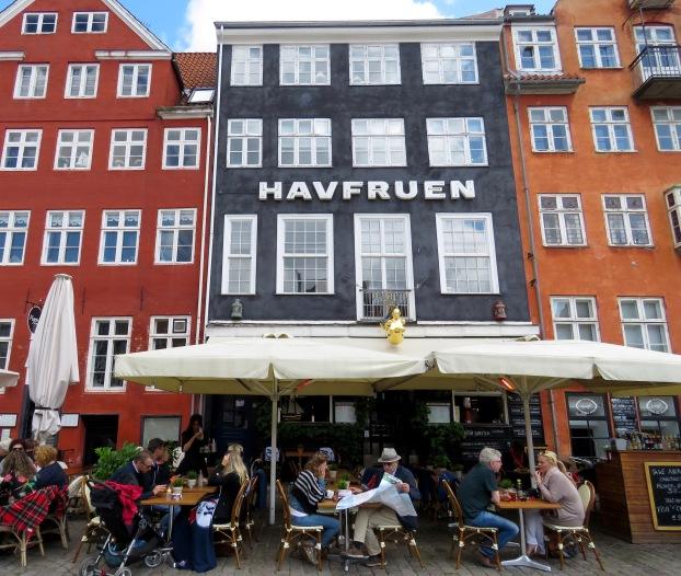"Diners enjoy a meal on the patio of HavFruen ""The Little Mermaid"" Restaurant in Copenhagen - Read about the sites and activities in Copenhagen, Denmark at www.beautifulfillment.com"