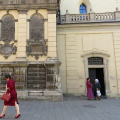 Woman in Red - Lviv, Ukraine - by Anika Mikkelson - Miss Maps