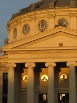 A setting sun shines upon the Romanian Athenaeum - Bucharest, Romania - by Anika Mikkelson - Miss Maps - www.MissMaps.com