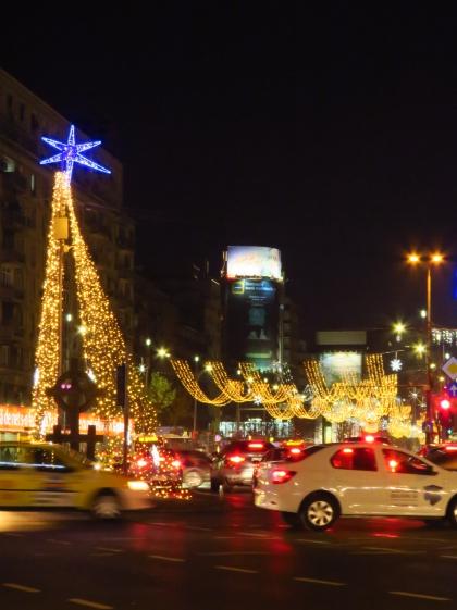 Piatsa Romana shines brightly in the Christmas Spirit - Bucharest Romania - by Anika Mikkelson - Miss Maps - www.MissMaps.com