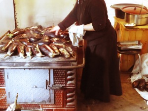 Roasting Eggplants on a Wood Burning Stove in the Lower Kitchen - Monastery of Romania - by Anika Mikkelson - Miss Maps