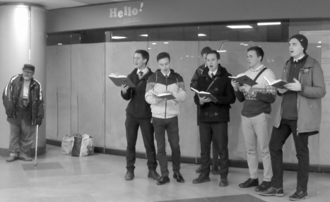 Singing Christmas Carols in the underground Piatsa Universitatii - - Bucharest Romania - by Anika Mikkelson - Miss Maps - www.MissMaps.com