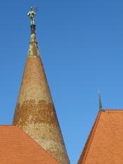 Statue of Hunedor atop Hunyad Castle (Castelul Huniazilor) in Hunedoara, Romania by Anika Mikkelson - Miss Maps - www.MissMaps.com
