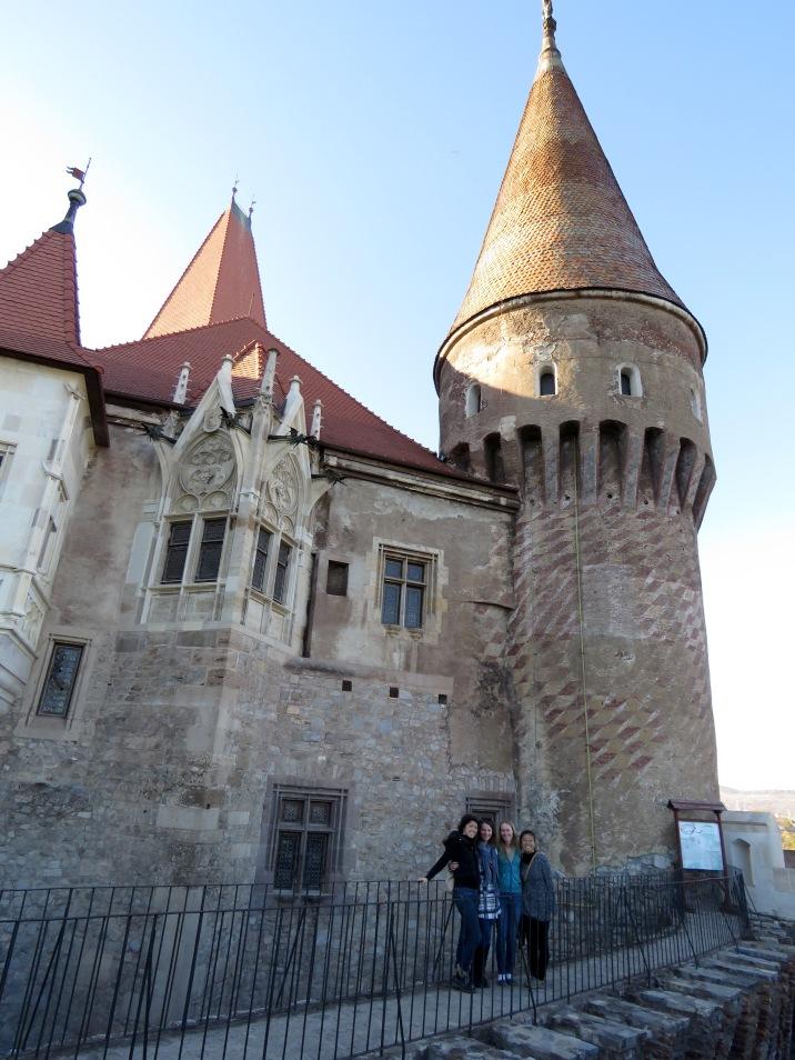 The lovely volunteers outside of the spooky Hunedoara Castle in Transylvania, Romania - Anika Mikkelson - Miss Maps - www.MissMaps.com