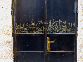 An arched door depicting a scene of Jerualem within the Jewish Quarter - by Anika Mikkelson - Miss Maps - www.MissMaps.com