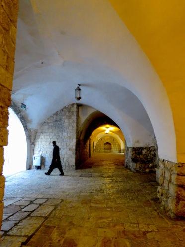 An Orthodox Jew walks to his place of study on Mount Zion in Jerusalem Israel - by Anika Mikkelson - Miss Maps - www.MissMaps.com