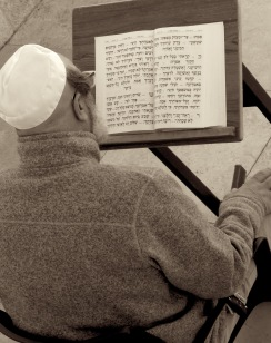 At Jerusalem's Western Wall, a man sits singing his afternoon prayer - by Anika Mikkelson - Miss Maps - www.MissMaps.com