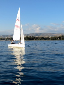 Boys and their toys - two sailors at practice in Limassol Cyprus - by Anika Mikkelson - Miss Maps - www.MissMaps.com