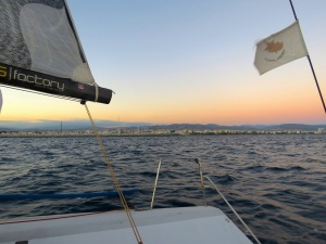 Cyprus's flag at sundown from the sailboat - Limassol Cyprus - by Anika Mikkelson - Miss Maps - www.MissMaps.com