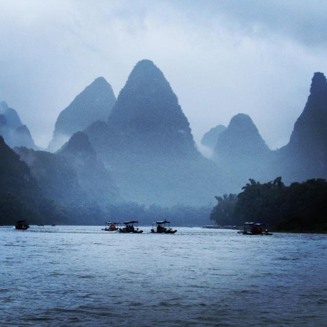 Floating down the Li River in Yangshuo by Mikayla Timothy - MissMaps.com