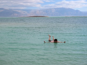 He's floating, he's floating! In The Dead Sea at Ein Gedi Israel - by Anika Mikkelson - Miss Maps - www.MissMaps.com