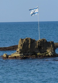 Israeli Flag waving in the Mediterranean Sea off Old Jaffa Coast - Tel Aviv Israel - by Anika Mikkelson - Miss Maps - www.MissMaps.com