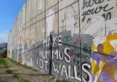 Make Hummus Not Walls - Grafitti on the wall surrounding present-day Palestine - by Anika Mikkelson - Miss Maps - www.MissMaps.com