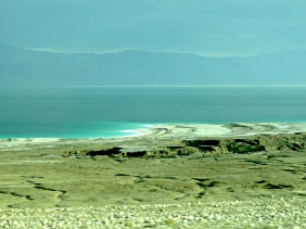 The Dead Sea's spectacular colors created by salt deposits along the shore - by Anika Mikkelson - Miss Maps - www.MissMaps.com