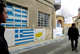 The Grecian Flag painted onto Old Town Nicosia's walls - by Anika Mikkelson - Miss Maps - www.MissMaps.com