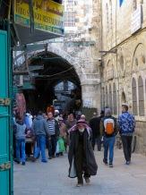 In the busy maze of Jerusalem's walled city, an elder walks alone