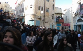 Tourists and Locals alike try to get to Manger Square in Bethlehem - by Anika Mikkelson - Miss Maps - www.MissMaps.com