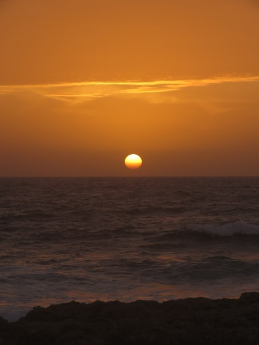 Watching the sun set over the Mediterranean Sea in Paphos, Cyprus - by Anika Mikkelson - Miss Maps - www.MissMaps.com