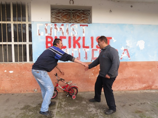 """Take a ride on the tricycle"" Their faces say it all - Shkoder Albania - by Anika Mikkelson - Miss Maps - www.MissMaps.com"