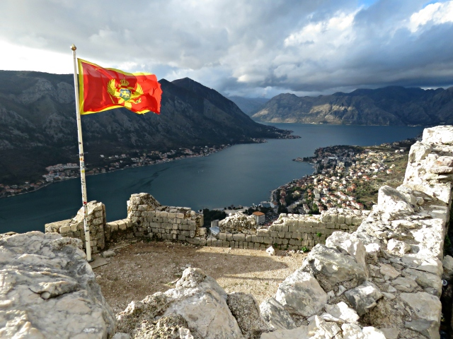 Albania's Flag from the top of Kotor Fortress - Kotor Montenegro - by Anika Mikkelson - Miss Maps - www.MissMaps.com