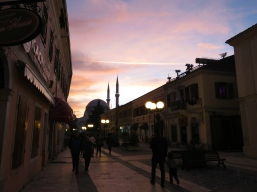Pjaca Kol Idromeno Pedestrian Street at Dusk - Shkoder Albania - by Anika Mikkelson - Miss Maps - www.MissMaps.com