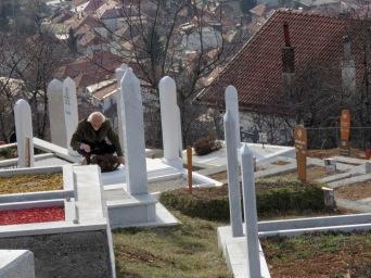 Tending to his wife's grave - Sarajevo, Bosnia and Herzegovina BiH - by Anika Mikkelson - Miss Maps - www.MissMaps.com