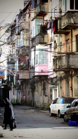Woman Walking in Shkoder Albania - by Anika Mikkelson - Miss Maps - www.MissMaps.com