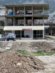 An Internet Cafe and Clothes Dryer in One - Gjirokaster Albania - by Anika Mikkelson - Miss Maps - www.MissMaps.com