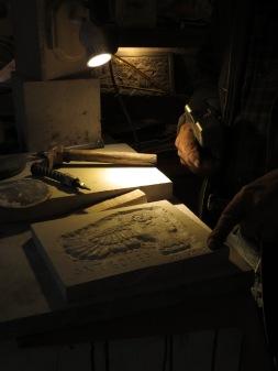 Dimly Lit Sculpting by Muhedin Makri of Gjirokaster Albania - by Anika Mikkelson - Miss Maps - www.MissMaps.com