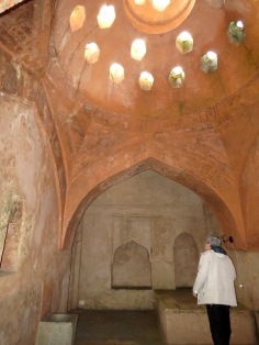 Our Host showing us empty rooms of the Turkish Bathhouse - Elbasan Albania - by Anika Mikkelson - Miss Maps - www.MissMaps.com