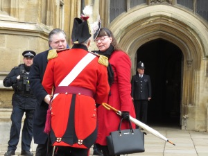 They must be important - a couple gets chummy with one of the guards outside St. George's Cathedral at Windsor Palace - Windsor, London, UK - by Anika Mikkelson - Miss Maps - www.MissMaps.com