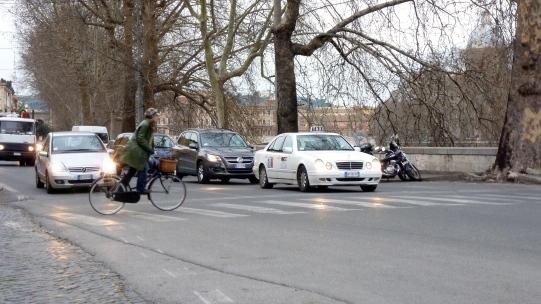 A bike rider in Rome Italy - by Anika Mikkelson - Miss Maps - www.MissMaps.com