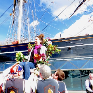 Being lifted up in the flower : fertility chair of Blackheath Morris Men and Cutty Shark Ship in Greenwich London UK - by Anika Mikkelson - Miss Maps