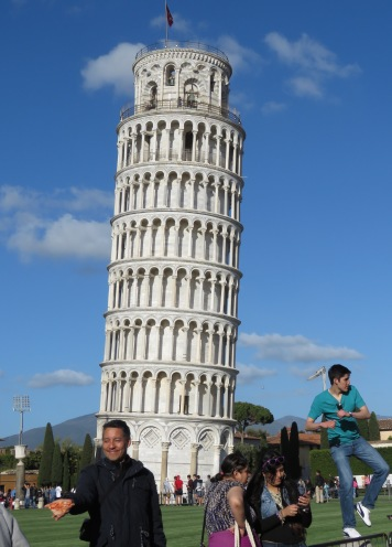 Here we have a kung fu master, selfie preppers and my favorite, a guy with pizza. Pizza in Pisa. - Leaning Tower of Pisa, Italy - by Anika Mikkelson - Miss Maps - www.MissMaps.com
