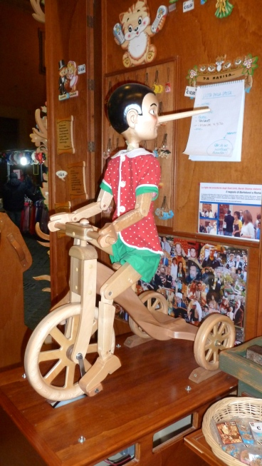 Pinocchio Rides his bike in Rome Italy - by Anika Mikkelson - Miss Maps - www.MissMaps.com