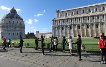 They're all posers (The tower is to our left) - Leaning Tower of Pisa, Italy - by Anika Mikkelson - Miss Maps - www.MissMaps.com
